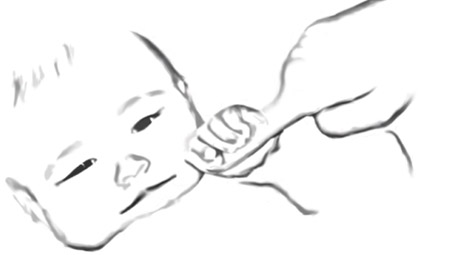 Samurai baby holding parents finger